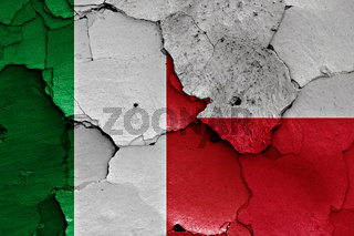 flags of Italy and Poland painted on cracked wall