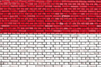 flag of Monaco painted on brick wall