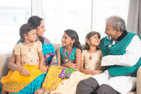 Indian family indoors portrait