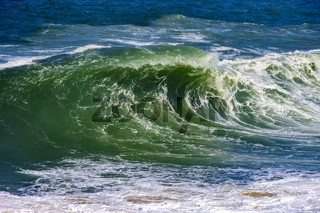 Stormy wave with green water
