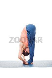 Woman doing Ashtanga Vinyasa Yoga asana Padangushthasana