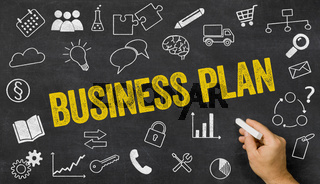 Business plan written on a blackboard with icons