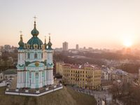 View of St. Andrew's Church and the historical Podol part of the city Kiev, Ukraine