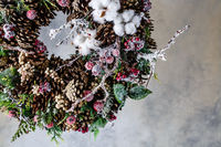 Christmas wreath with cones and berries and leaves