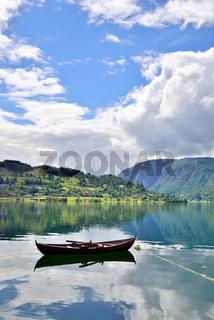 Single rowboat in a fjord in Ulvik
