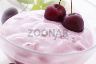 Cherry jogurt with cherry as closeup in a bowl
