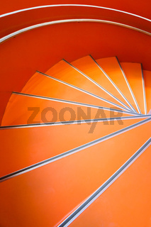 Abstract spiral orange staircase background