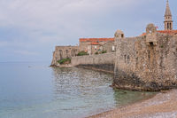 Thick walls of the old town fort in Budva