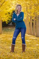 Beautiful Blonde Model Posing In A Field Of Yellow Leaves