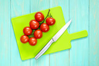 The branch of cherry tomatoes and knife