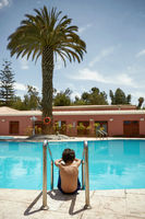 Young Boy Enjoying Vacation at Tropical Swimming Pool in Arequipa, Peru