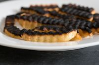 Plate of ruined and burned french fries