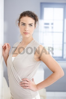 Attractive woman standing front of window