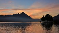 Mount Niesen at sunset. Colorful clouds over lake Thunersee. View from Neuhaus, Switzerland.