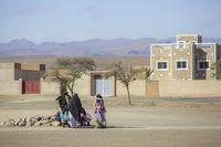 Tinghir, Morocco - February 27, 2016: Women sitting outside house