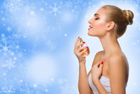 Young healthy woman on winter background