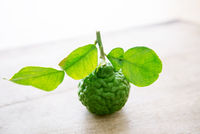 Organic kaffir lime on wooden background