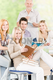 Group of high-school students with mature professor