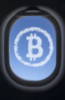 Icon bitcoin made from clouds against the blue sky