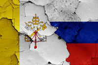 flag of Vatican and Russia painted on cracked wall