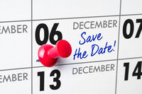Wall calendar with a red pin - December 06