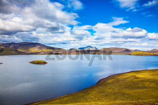 Cool lake among the yellow tundra