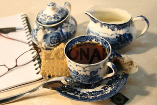 Cup of english breakfast tea with cookies