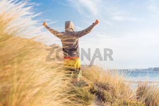 Sporty active man enjoying beauty of nature.