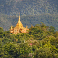 Temple and mountains. Beautiful landscape. Laos.