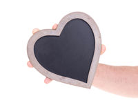 Adult holding heart shaped chalkboard