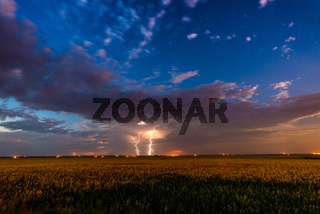 Lightning bolt from clouds over a field
