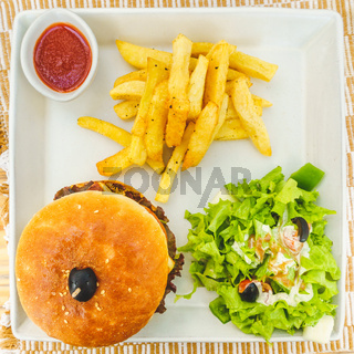 Burger with salad and  chips