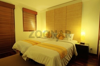 Photo of bed with a table lamp