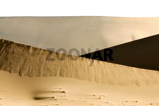 Big sand dune contrasts. Desert or beach sand textured background.