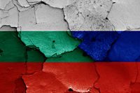 flags of Bulgaria and Russia painted on cracked wall
