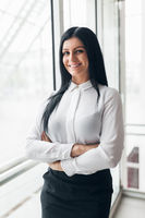 Successful confident young business woman in an office setting