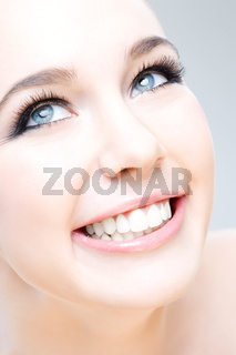 young caucasian woman smiling happily