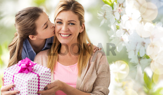 daughter kissing mother and giving her present