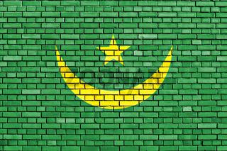flag of Mauritania painted on brick wall