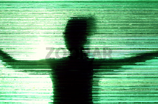 Woman silhouette behind textured glass wall