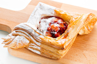 Open pies of puff pastry pies with cranberries, apples and honey.