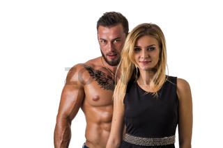 Shirtless, fit muscular man and beautiful blonde woman