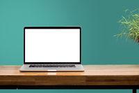 laptop blank screen on wooden desk