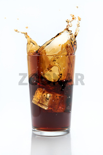 Glass of cola with splash