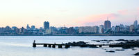 Sunset scene of beach and skyline at background in Montevideo, Uruguay