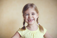 Happy lost tooth little girl portrait