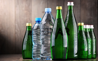 Composition with different sorts of bottles containing mineral water.