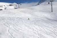 Skiers downhill on ski slope
