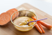 vegetable puree or baby food in bowl with spoon