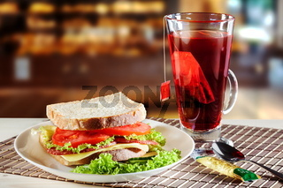 Sandwich and red fruit tea